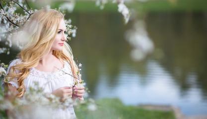 Blondy girl in white dress