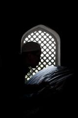 man prays at the mausoleum