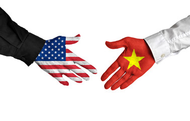 United States and Vietnam leaders shaking hands on a deal agreement