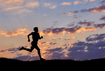 Silhouette of man runner at sunset