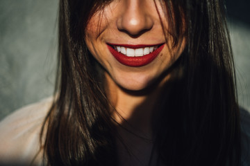 Portrait of a smiling woman with red lipstick