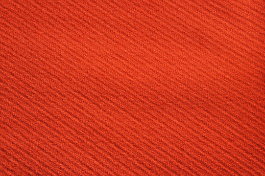 The texture of the woolen cloth of red color