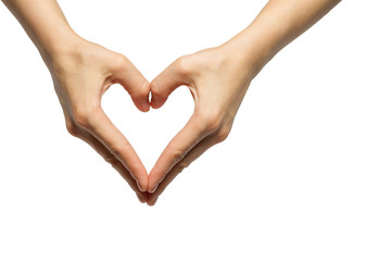 girl's hands serried in a heart shape on isolated background