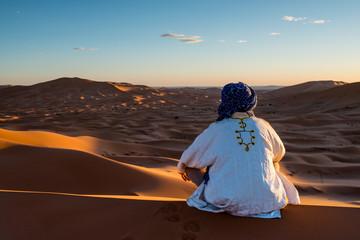 Man looks in the desert