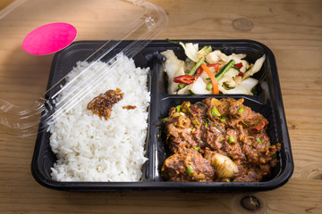 Convenient take-away meal box with rice, meat and vegetable
