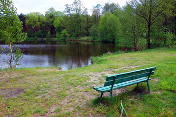 lonely bench over lake