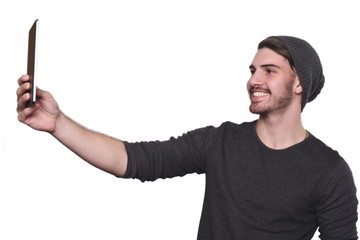 Young man taking selfie with tablet.