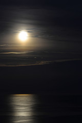 Full moon over the sea waves