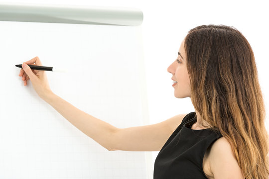 Business woman writing on a white board