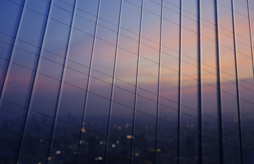 Fototapete - Reflection of blurred aerial view of cityscape on warm light sun