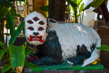Sculpture. Animal with 5 eyes. Thailand. Chiangmai.