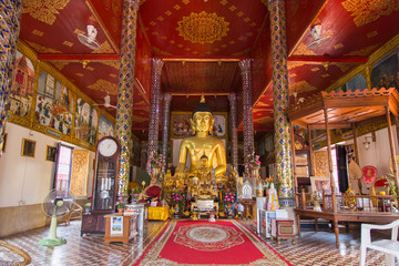 Golden buddha statue at Temple Phra That Hariphunchai in Lamphun, Province Lamphun, Thailand.