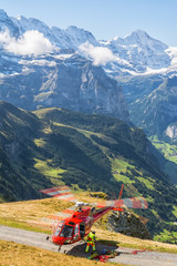 View of rescue red helicopter with spectacular landscape at background