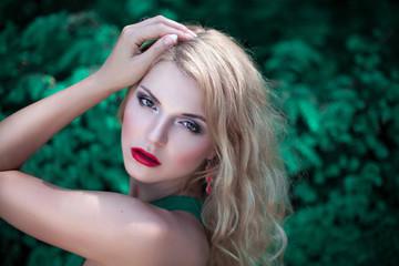 Beautiful woman on green nature background