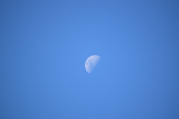 Moon in a blue sky.