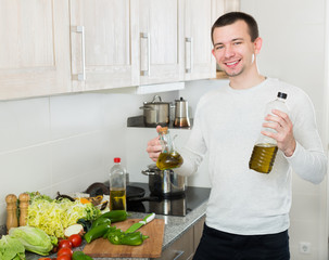 Male with olive oil bottle