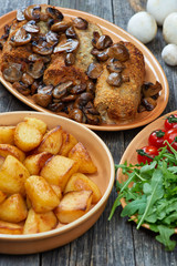 roulade of pork with roasted mushrooms and potatoes