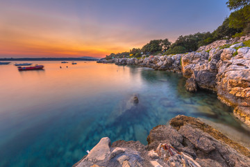 Wall Mural - Colorful sunset over the rocky coast of Croatia