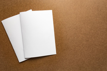 Brown paper note on business wood desk with copy space.