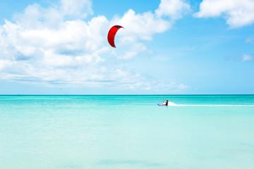 Kite surfer surfing on the Caribbean Sea at Aruba island
