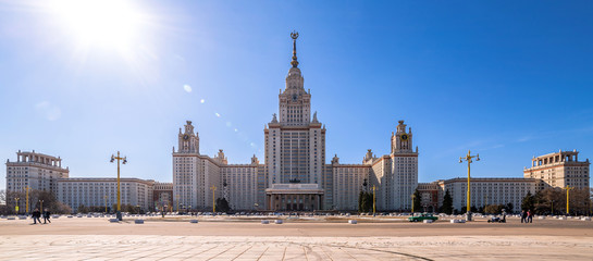 Wide angle view of spring sunny campus of Moscow University under blue sky