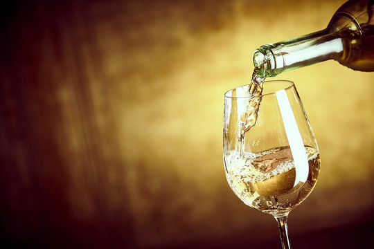 Banner ofPouring a glass of white wine from a bottle