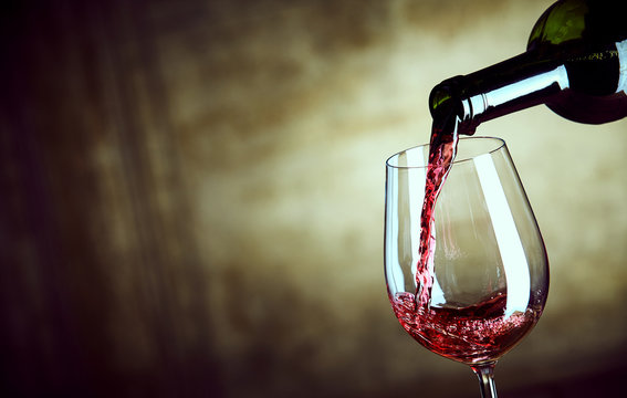 Serving a single glass of red wine from a bottle