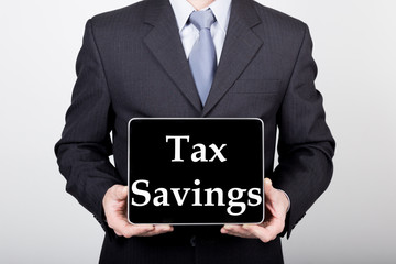 technology, internet and networking in business concept - businessman holding a tablet pc with tax savings sign. Internet technologies in business