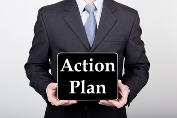 technology, internet and networking in business concept - businessman holding a tablet pc with action plan sign. Internet technologies in business