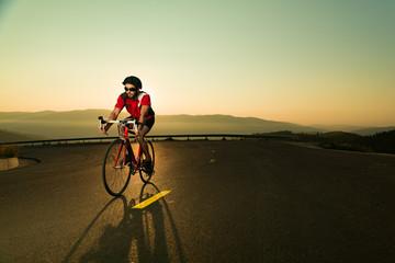 biker on road bike