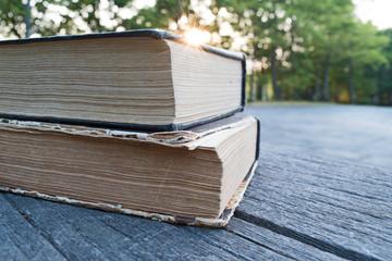 Books on wooden bench background sunrise