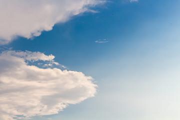 Clouds against blue sky.