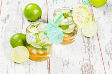 Mojito lime drinks on wooden background