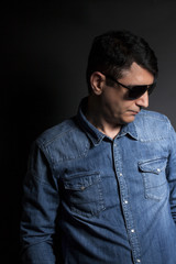 Portrait of man in Blue jean shirt with sunglasses