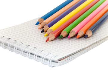 colored pencils on a notepad