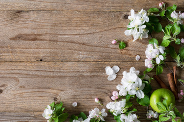 Wooden background with apple blossom flowers. 