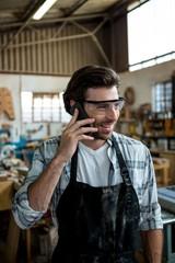 Carpenter calling someone