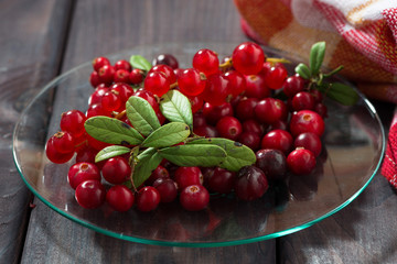 cowberries and red currants in a glass plate