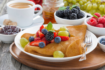 crepes with fresh berries and honey, coffee for breakfast