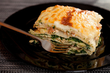 Typical Italian lasagna with spinach and salmon