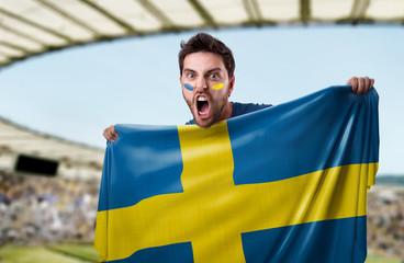 Fan holding the flag of Sweden