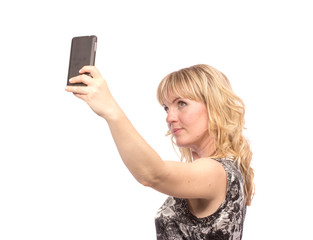 Beautiful woman taking self picture with smartphone camera