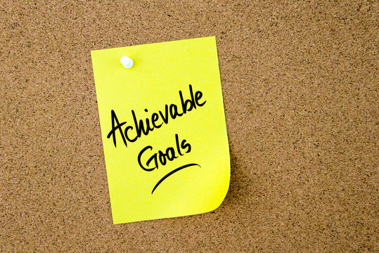 Achievable Goals written on yellow paper note