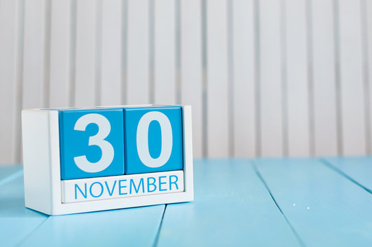 November 30th. Image of november 30 wooden color calendar on blue background. Autumn day. Empty space for text