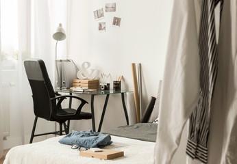Spacious bedroom filled with designer's paraphernalia
