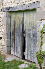 Old wooden doors to a barn in bad condition