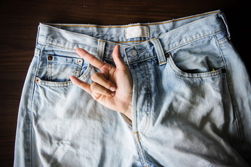 Hand inside jeans is meaning sexual