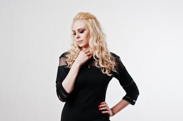 Close up studio portrait of  blonde girl in black dress