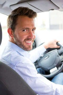 Young attractive man driving his car