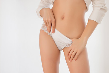 Young woman in white panties isolated on background